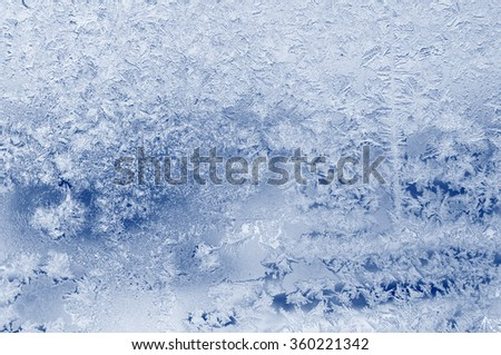Ice rime pattern on frozen glass. Abstract natural background - stock photo