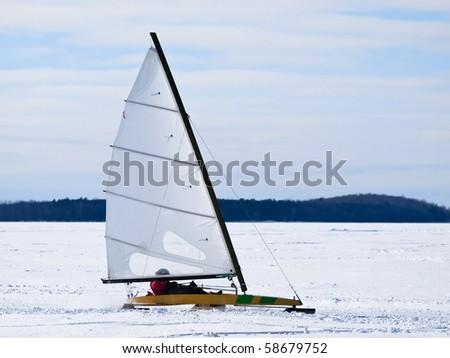 Ice sailing on the frozen lake - stock photo