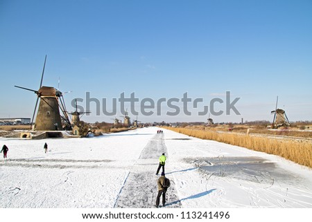 Ice skating at Kinderdijk in the Netherlands - stock photo