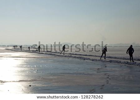 ice skating on lake Rottemeren  near  Rotterdam - stock photo