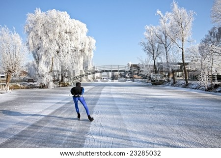 Ice skating on the canals in the countryside from the Netherlands - stock photo