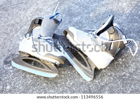 ice skating outdoors on a freezing winter - stock photo