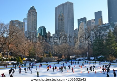 Ice-skating people with white Christmas in Central Park on December 11, 2013 in Manhattan, New York City, USA. - stock photo