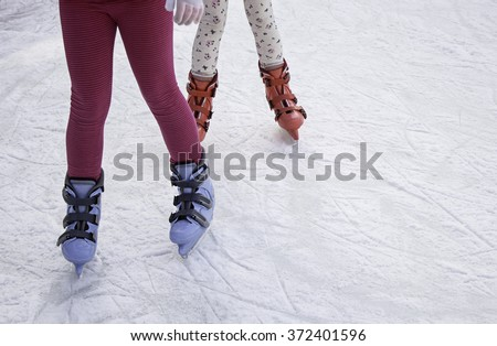 Ice skating rink, fun and entertainment - stock photo