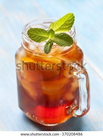 ice tea with mint and lemon in Mason jar - stock photo