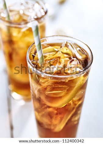 ice tea with straw closeup - stock photo