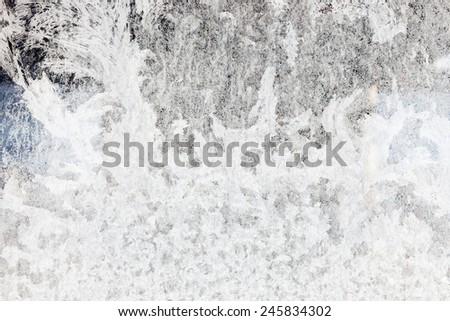 Ice texture on frozen window - stock photo
