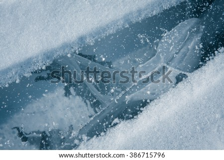 Ice with cracks abstract nature texture background