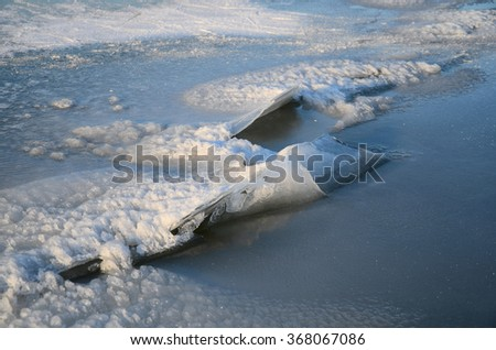 ice with cracks in the lake show details - stock photo