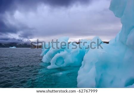 iceberg floating along greenland coasts - stock photo