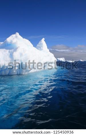 Iceberg floating in Antarctica - stock photo