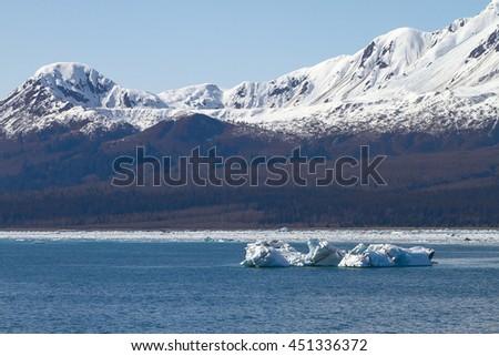 Iceberg Floating in Sea Close to Hubbard Glacier in Alaska. - stock photo