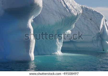 Iceberg in Antarctica close-up seen from a Dinghy - stock photo