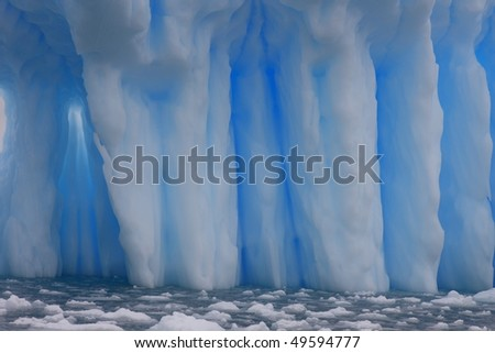 Iceberg in Antarctica seen from a dinghy - stock photo