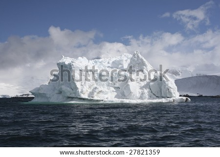 Iceberg in Antarctica waters - stock photo