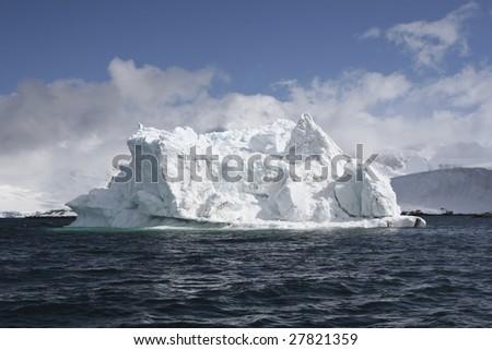 Iceberg in Antarctica waters - stock photo