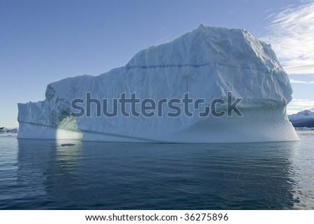 Iceberg in arctic waters - stock photo