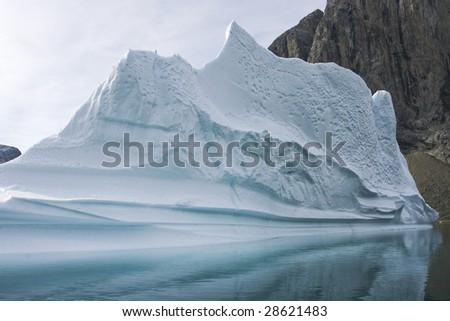 Iceberg in Arctic waters (Napassorsuaq Fjord, Greenland) - stock photo