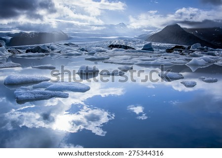 Iceberg in Jokulsarlon glacier lake in Iceland. The icebergs, originating from the Vatnajokull float. This location was used for various action movies. - stock photo