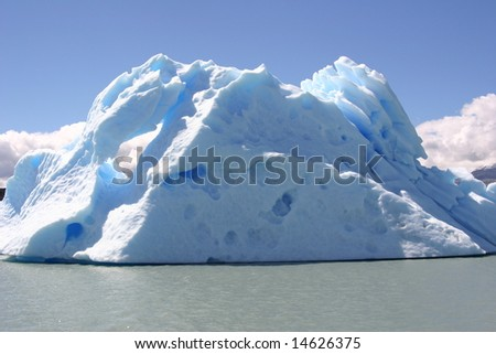 Iceberg in lake in Los Glaciares National Park, Calafate, Patagonia, Argentina with blue background