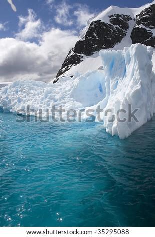 Iceberg in Paradise Bay, Antarctica - stock photo