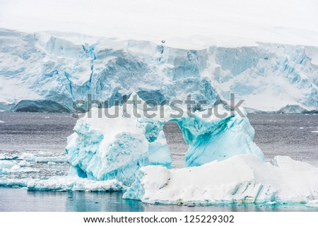 Iceberg of Antarctica, the southernmost continent and is surrounded by the Southern Ocean.