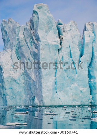 Iceberg on Spitsbergen island reflecting in water