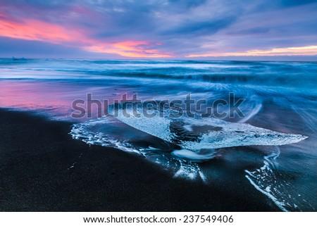 Iceberg on the beach - stock photo
