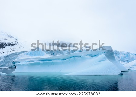 Iceberg on the surface of the Atlantic Ocean in Antarctica