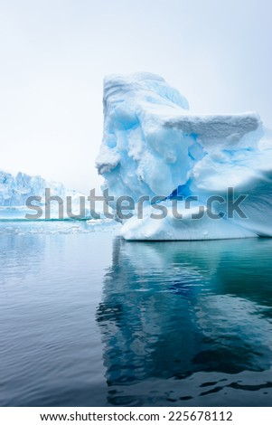 Iceberg on the surface of the Atlantic Ocean in Antarctica - stock photo
