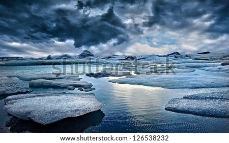 Icebergs against Stormy Sky in Iceland - stock photo