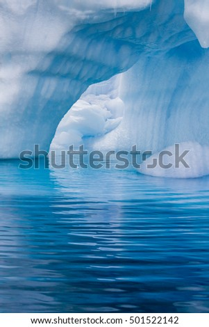 Icebergs and ice blue water of Antarctica