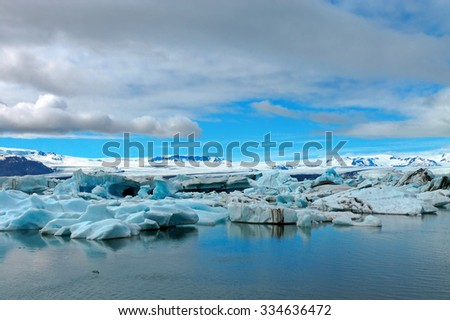Icebergs at the glacier lagoon Jokulsarlon in Iceland - stock photo
