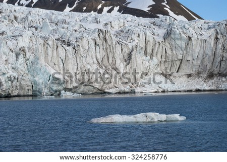 Icebergs in front of the glacier and mountains behind, Svalbard, Norway
