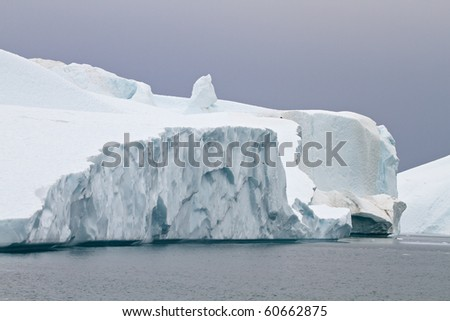 Icebergs in the famous icefjord beside the city of Ilulissat in Greenland. The icefjord is on UNESCO's World Heritage List.