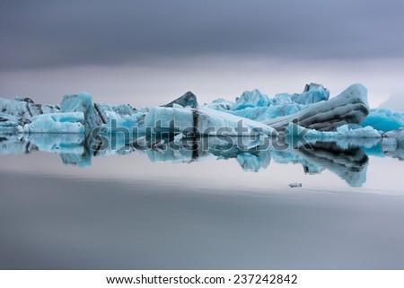 Icebergs on the lake. - stock photo