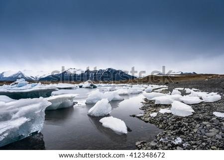 Icebergs on the shore of Jokulsarlon glacier lagoon - stock photo