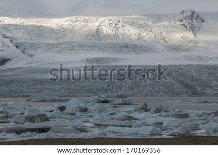 icebergs with glacier behind - stock photo