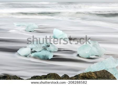Iceblock on the black beach at Jokulsarlon - stock photo