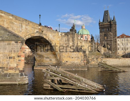 Icebreakers before the pillars of the Charles Bridge, Prague - stock photo