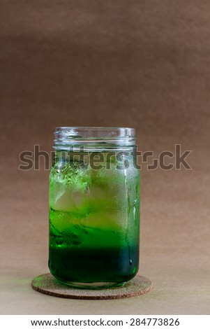 Iced beverage in mason jar glass background vintage. - stock photo