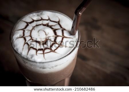 Iced chocolate on wood background - stock photo