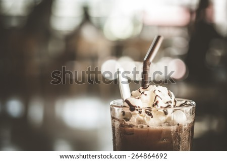 Iced cocoa and whipped cream topped with chocolate, Color Effect - stock photo