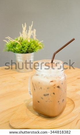 Iced cofee mocha drink serving on wooden table, stock photo - stock photo