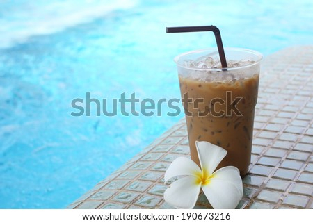 Iced coffee and flower - stock photo