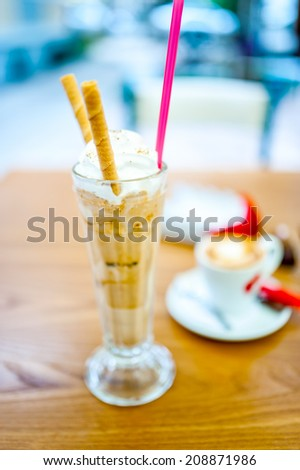 Iced coffee, frappe, with whipped cream, almonds cream and cookie - stock photo