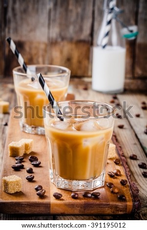 Iced coffee in glass on wooden table - stock photo
