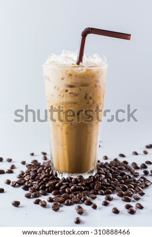 Iced coffee in glass with straw isolated on white background