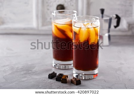 Iced coffee in tall glasses on the table - stock photo