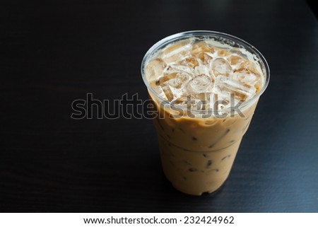 Iced coffee latte on wood table. - stock photo